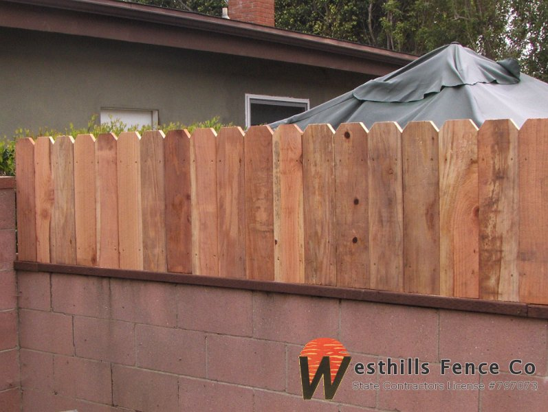 how to build a fence on top of a wall